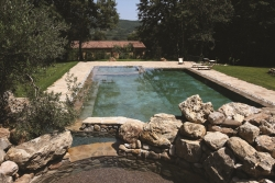 colored gravel and natural stone for the pool