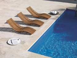 wood chaise longue beside the pool