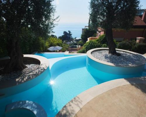 A swimming pool among olive trees italian pool technology for Italian pool design 7