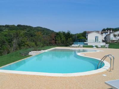 A swimming pool on the green hills of the Marche Region